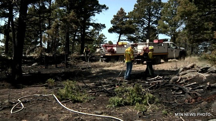 Emergency crews tackled down a small wildland fire in hot and dry conditions on Boulder Hill on Tuesday.