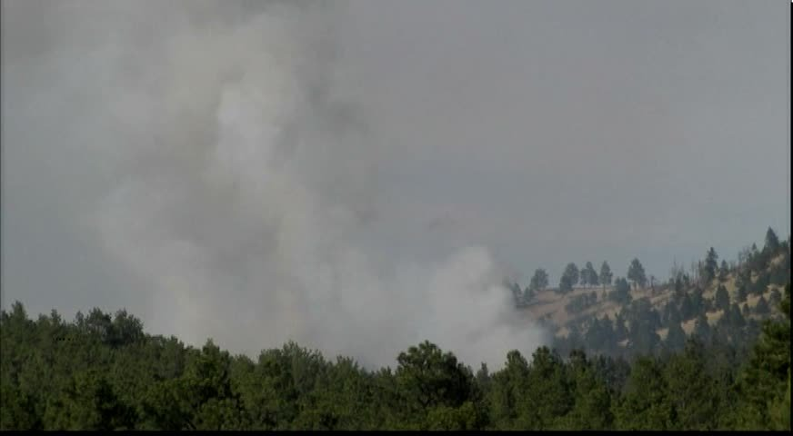 Crews are attacking the fire from the air by helicopter.