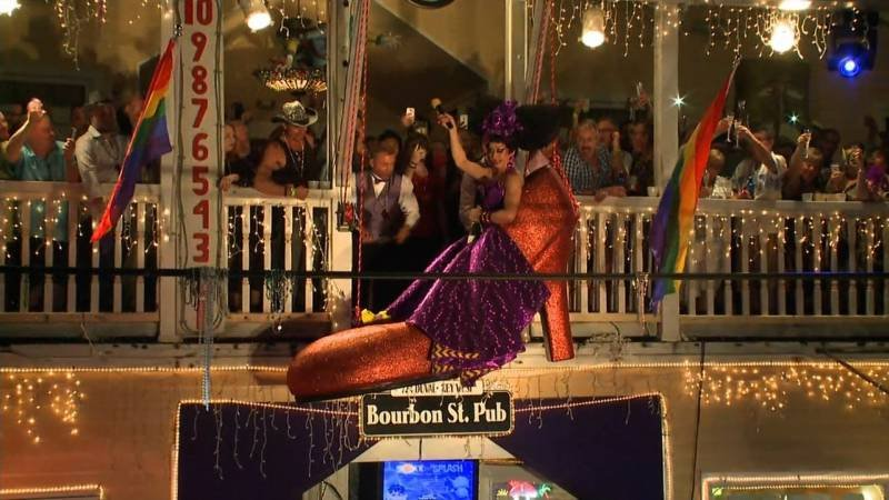 "(FILE) Gary ""Sushi"" Marion is lowered in a massive red shoe from the balcony of Bourbon Street Pub in Key West, Florida, on December 31, 2014."